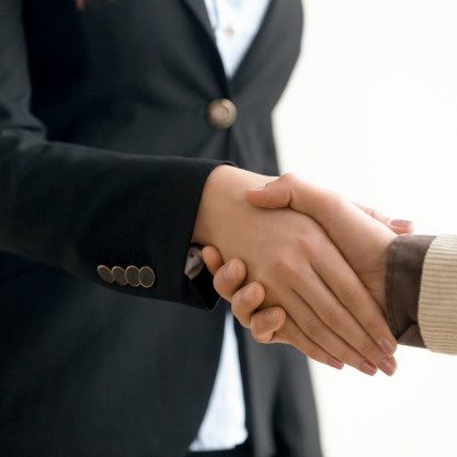 businessman-businesswoman-shaking-hands-business-handshake-close-up-view_1163-4238